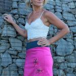 LaJuPe dívčí sukně polyester_viskóza_bez_podšívky_sytě růžová_petrol_áčková_1kapsa_úplet_petrol_růžová_květiny_2kytky